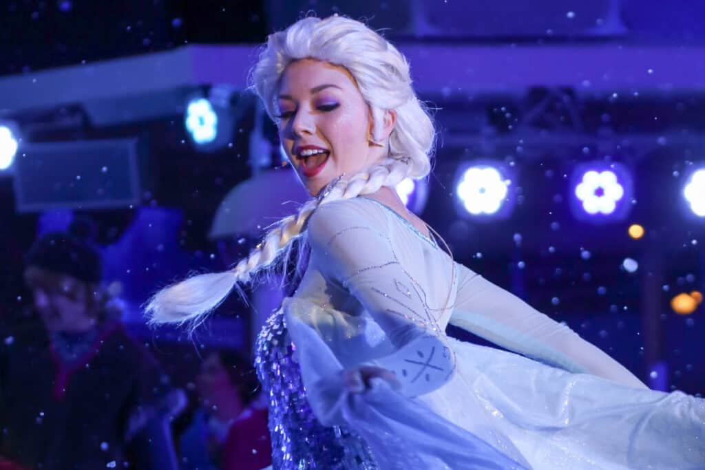 actor dressed as elsa for frozen birthday party
