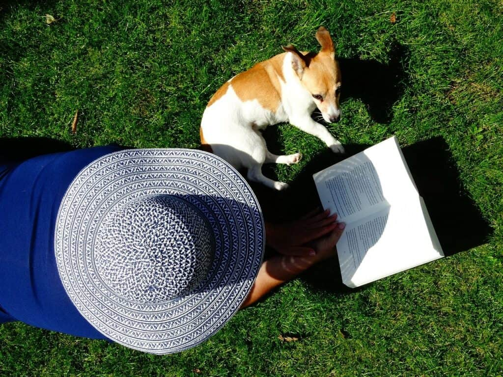 lady reading with dog
