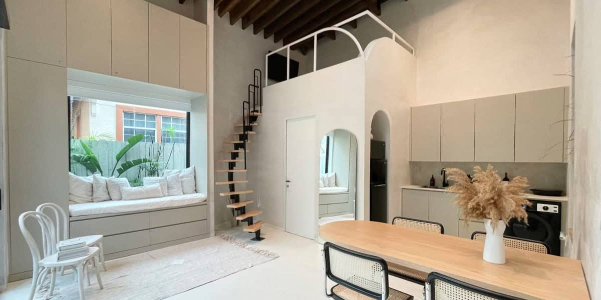 Bright and modern Miami studio rental with spiral staircase