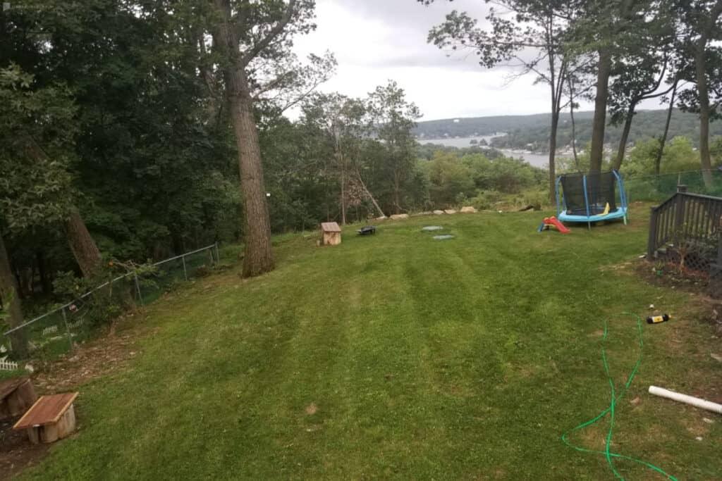 a home with spacious yard and lake views