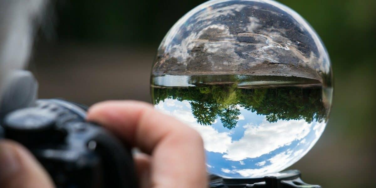 photographer shooting glass ball