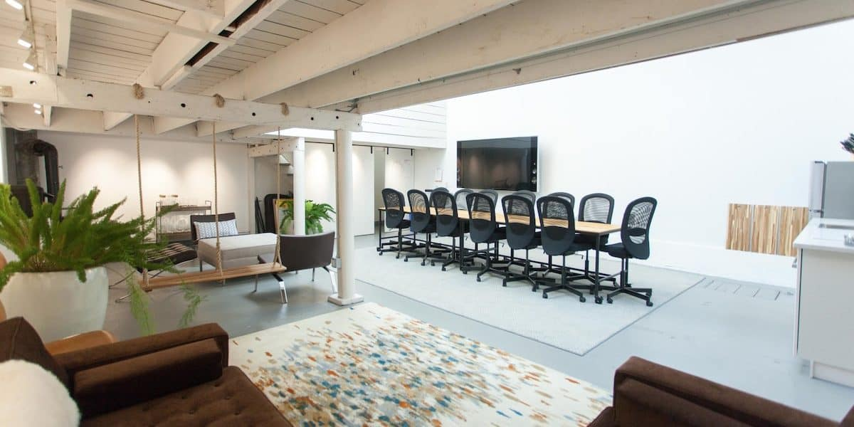 Multipurpose space for rent in San Francisco with conference tables, swing and couch