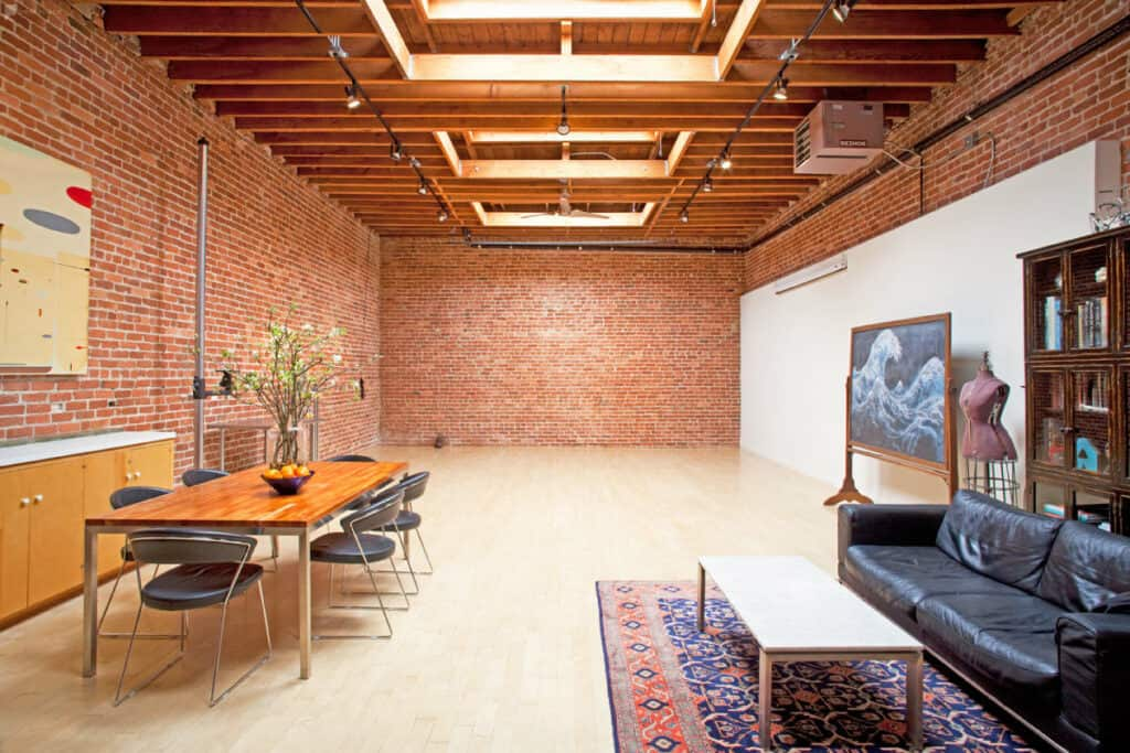 photo studio with brick wall and breakout space