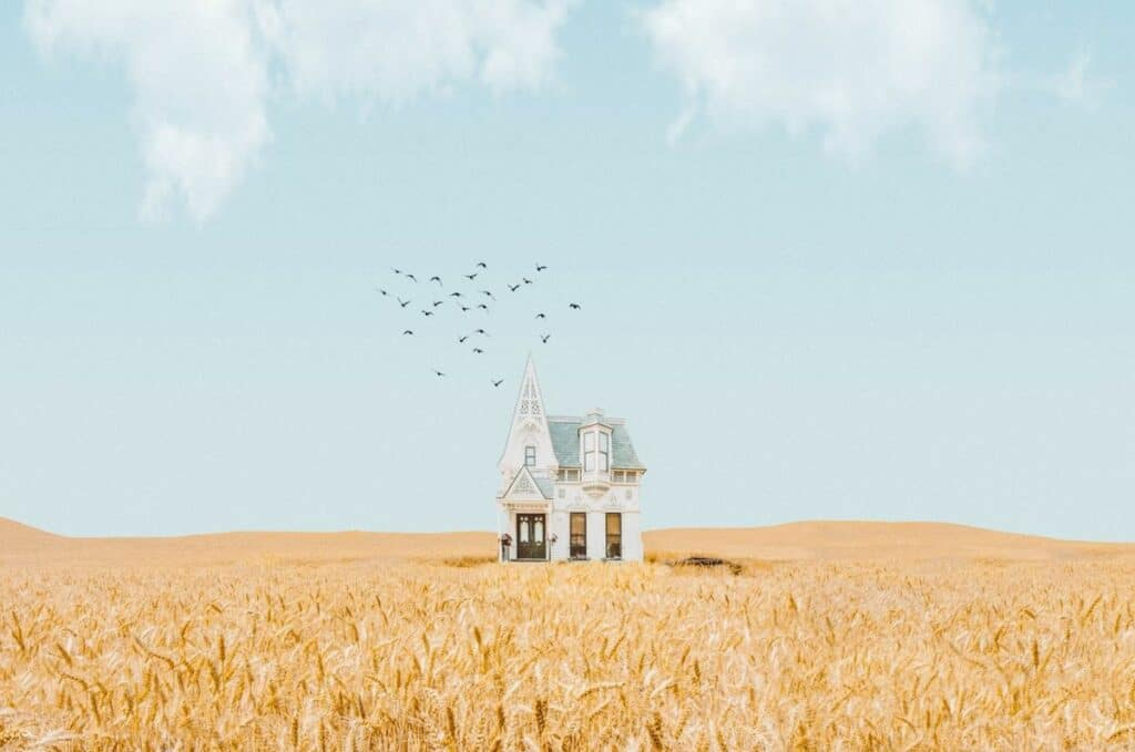 surreal photograph house in field